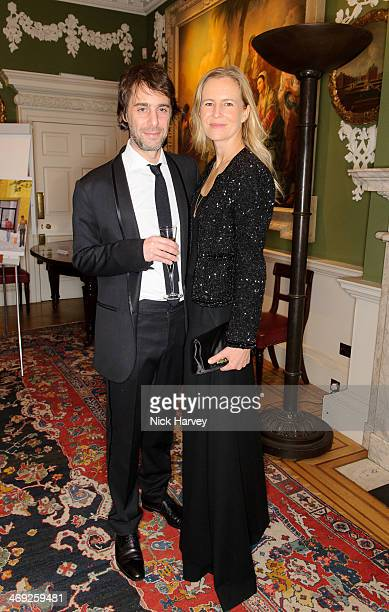 Alex Cochrane and Alannah Weston attend the Tokens of Love Dinner in aid of CORAM at The Foundling Museum on February 13 2014 in London England