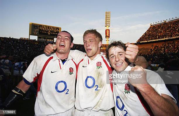 Alex Codling Lewis Moody and Andy Gomarsall of England celebrate victory after the Rugby Union International match between Argentina and England held...