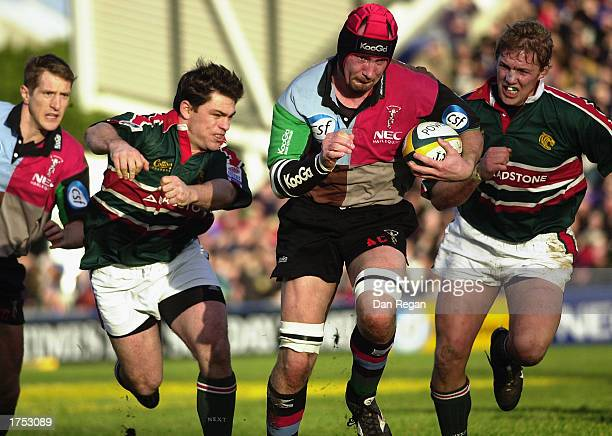 Alex Codling of Harlequins splits the Leicester Tigers defence during the Powergen Cup quarterfinal match between Harlequins and Leicester Tigers...
