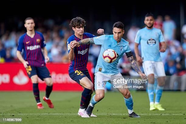 Alex Collado of FC Barcelona competes for the ball with Hugo Mallo of Celta de Vigo during the La Liga match between RC Celta de Vigo and FC...