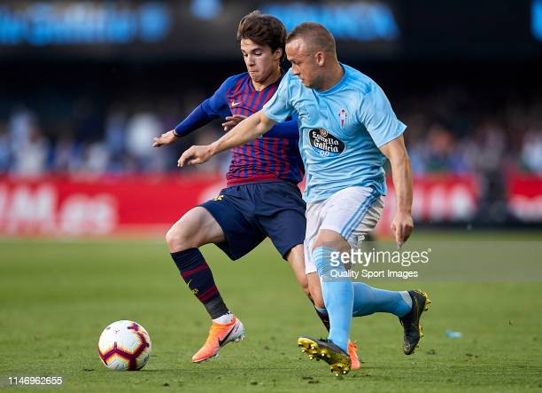 Alex Collado of FC Barcelona competes for the ball with Stanislav Lobotka of Celta de Vigo during the La Liga match between RC Celta de Vigo and FC...