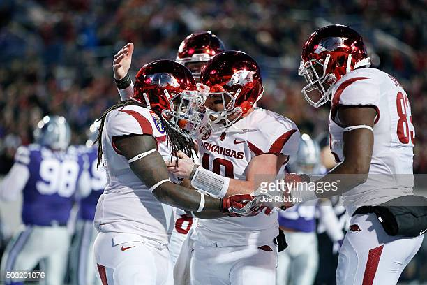 Alex Collins and Brandon Allen of the Arkansas Razorbacks celebrate after a 14yard touchdown against the Kansas State Wildcats in the fourth quarter...