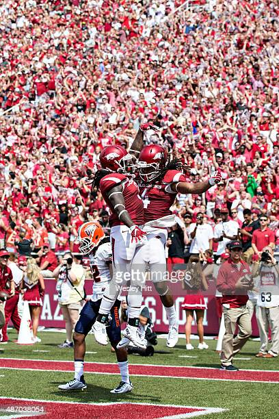 Alex Collins and Keon Harcher of the Arkansas Razorbacks celebrate after a touchdown against the UTEP Miners at Donald W Reynolds Razorback Stadium...