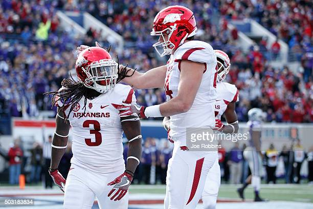 Alex Collins of the Arkansas Razorbacks celebrates after rushing for a 13yard touchdown against the Kansas State Wildcats in the second quarter of...