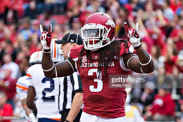 Alex Collins of the Arkansas Razorbacks celebrates with teammates after scoring a touchdown against the UT Martin Skyhawks at Razorback Stadium on...