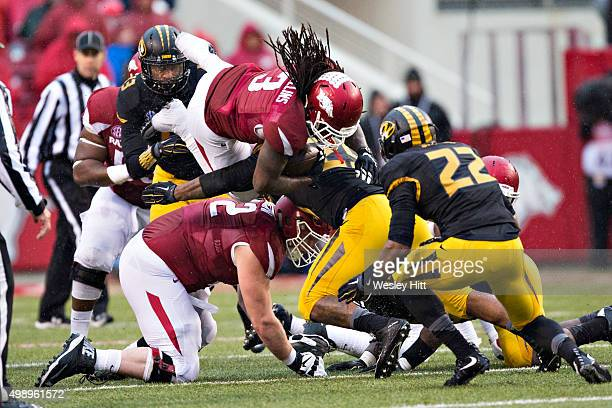 Alex Collins of the Arkansas Razorbacks dives over the defense during a game against the Missouri Tigers at Razorback Stadium Stadium on November 27...