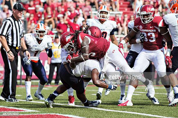 Alex Collins of the Arkansas Razorbacks is hit at the goal line but powers in for a touchdown against the UTEP Miners at Razorback Stadium on...