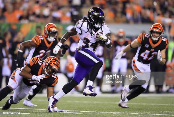 Alex Collins of the Baltimore Ravens carries the ball against the Cincinnati Bengals at Paul Brown Stadium on September 13 2018 in Cincinnati Ohio