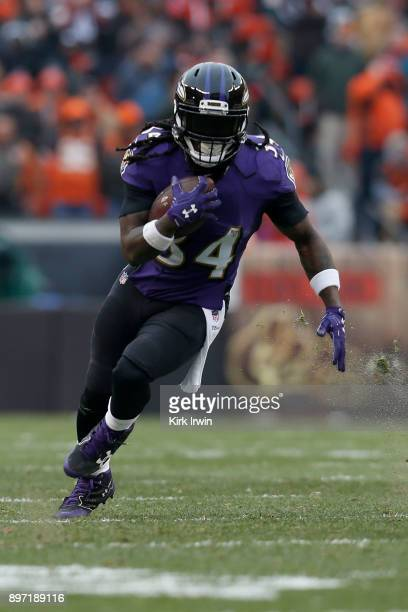 Alex Collins of the Baltimore Ravens carries the ball during the game against the Cleveland Browns at FirstEnergy Stadium on December 17 2017 in...