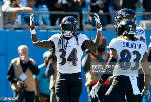 Alex Collins of the Baltimore Ravens celebrates a touchdown against the Carolina Panthers in the first quarter during their game at Bank of America...