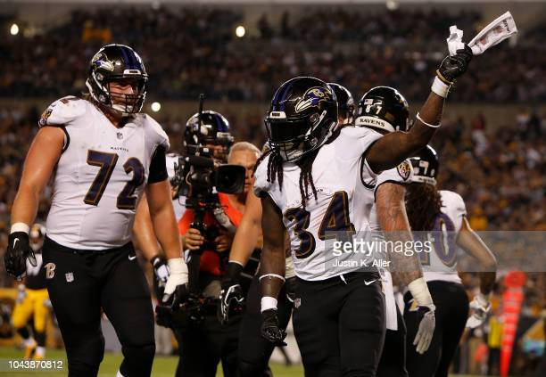 Alex Collins of the Baltimore Ravens celebrates after a 3 yard touchdown reception in the first quarter during the game against the Pittsburgh...
