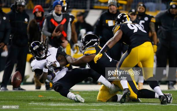 Alex Collins of the Baltimore Ravens fumbles the ball after being hit by Javon Hargrave of the Pittsburgh Steelers in the first quarter during the...