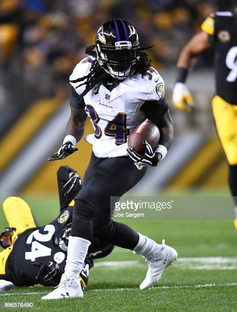 Alex Collins of the Baltimore Ravens in action during the game against the Pittsburgh Steelers at Heinz Field on December 10 2017 in Pittsburgh...