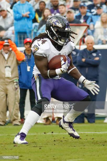 Alex Collins of the Baltimore Ravens plays against the Tennessee Titans at Nissan Stadium on October 14 2018 in Nashville Tennessee