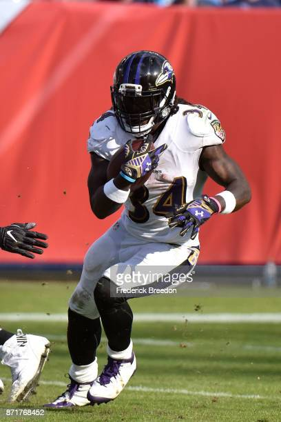 Alex Collins of the Baltimore Ravens plays against the Tennessee Titans at Nissan Stadium on November 5 2017 in Nashville Tennessee