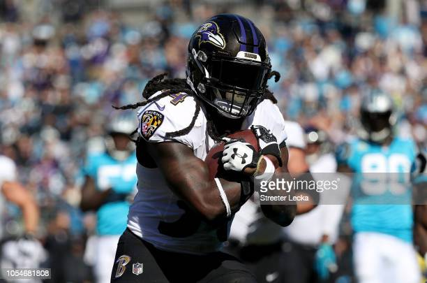 Alex Collins of the Baltimore Ravens runs for a touchdown against the Carolina Panthers in the first quarter during their game at Bank of America...