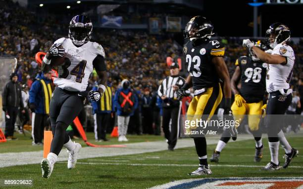 Alex Collins of the Baltimore Ravens runs into the end zone past Mike Mitchell of the Pittsburgh Steelers for a 18 yard touchdown in the second...