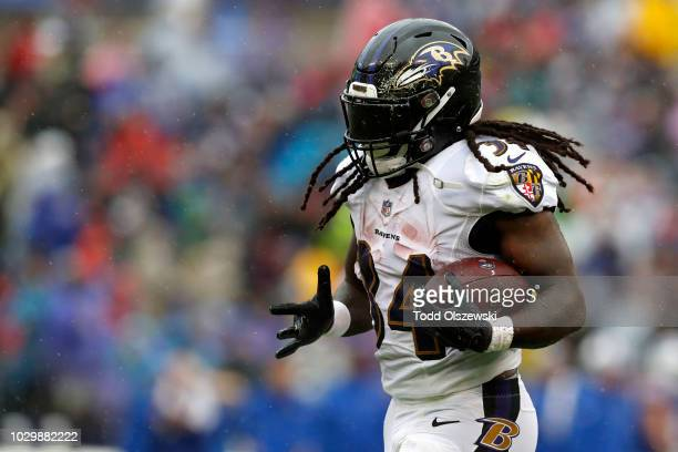 Alex Collins of the Baltimore Ravens runs off the field after a touchdown in the first quarter against the Buffalo Bills at MT Bank Stadium on...