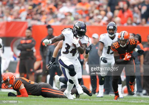Alex Collins of the Baltimore Ravens runs the ball for a first down in the second quarter against the Cleveland Browns at FirstEnergy Stadium on...