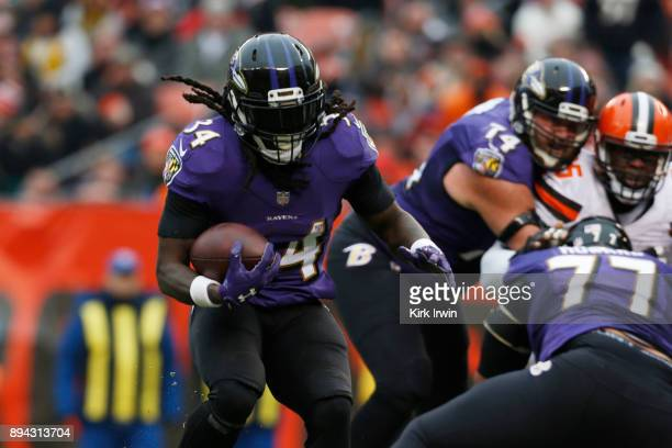 Alex Collins of the Baltimore Ravens runs the ball in the first half against the Cleveland Browns at FirstEnergy Stadium on December 17 2017 in...