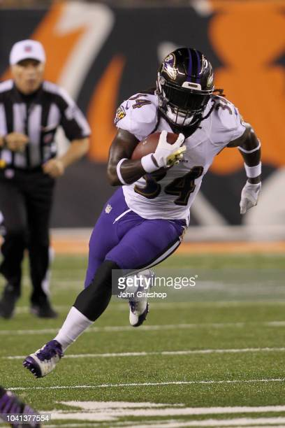 Alex Collins of the Baltimore Ravens runs the football upfield during the game against the Cincinnati Bengals at Paul Brown Stadium on September 13...