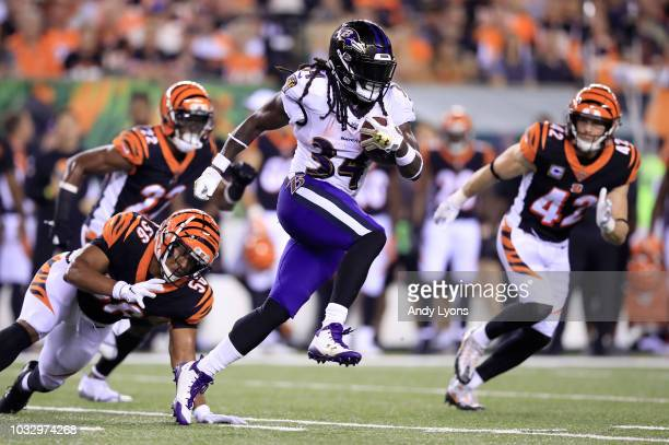 Alex Collins of the Baltimore Ravens runs with the ball against the Cincinnati Bengals at Paul Brown Stadium on September 13 2018 in Cincinnati Ohio