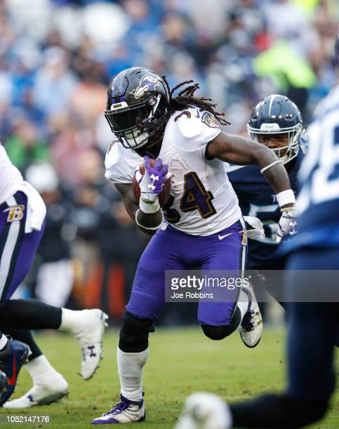 Alex Collins of the Baltimore Ravens runs with the ball against the Tennessee Titans during the second quarter at Nissan Stadium on October 14 2018...