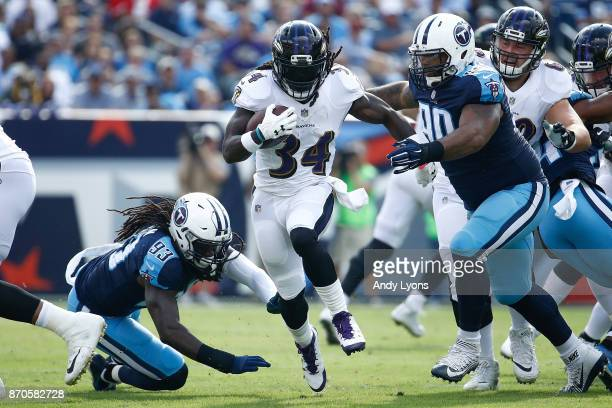 Alex Collins of the Baltimore Ravens runs with the ball against the Tennessee Titans during the first half at Nissan Stadium on November 5 2017 in...