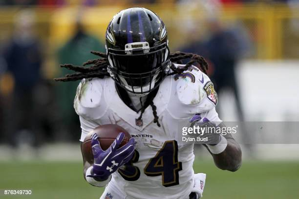 Alex Collins of the Baltimore Ravens runs with the ball in the fourth quarter against the Green Bay Packers at Lambeau Field on November 19 2017 in...