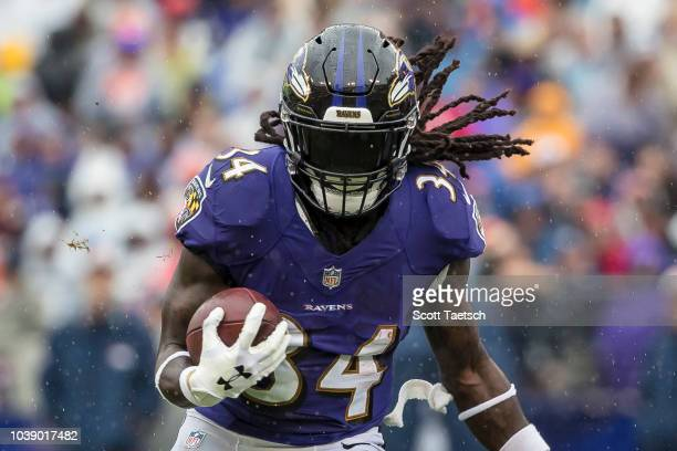 Alex Collins of the Baltimore Ravens rushes against the Denver Broncos during the first half at MT Bank Stadium on September 23 2018 in Baltimore...