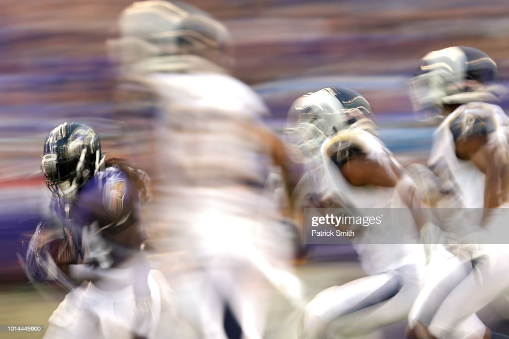 Alex Collins #34 of the Baltimore Ravens rushes against the Los Angeles Rams in the first half during a preseason game at M&T Bank Stadium on August 9, 2018 in Baltimore, Maryland.