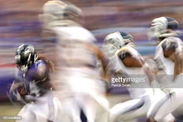 Alex Collins of the Baltimore Ravens rushes against the Los Angeles Rams in the first half during a preseason game at MT Bank Stadium on August 9...