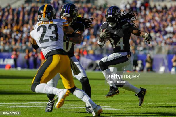 Alex Collins of the Baltimore Ravens rushes against the Pittsburgh Steelers during the second quarter at MT Bank Stadium on November 4 2018 in...