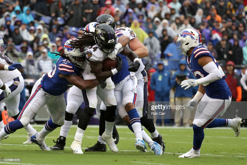 Alex Collins #34 of the Baltimore Ravens rushes for a touchdown in the first quarter against the Buffalo Bills at M&T Bank Stadium on September 9, 2018 in Baltimore, Maryland.
