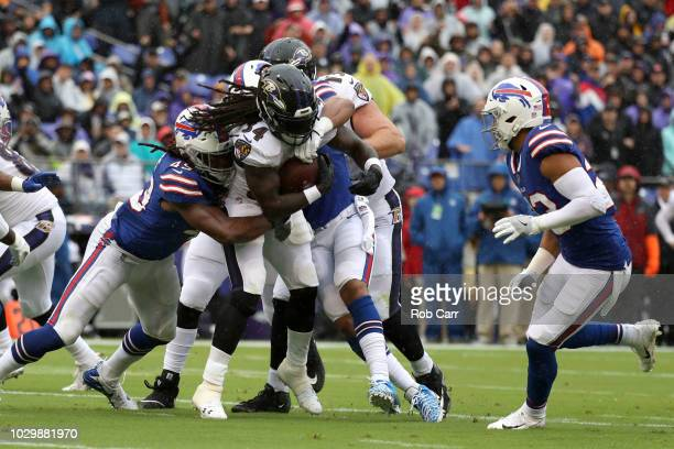 Alex Collins of the Baltimore Ravens rushes for a touchdown in the first quarter against the Buffalo Bills at MT Bank Stadium on September 9 2018 in...