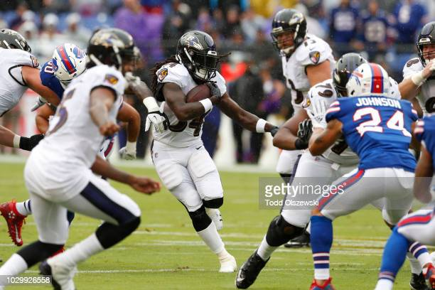 Alex Collins of the Baltimore Ravens rushes in the first quarter against the Buffalo Bills at MT Bank Stadium on September 9 2018 in Baltimore...