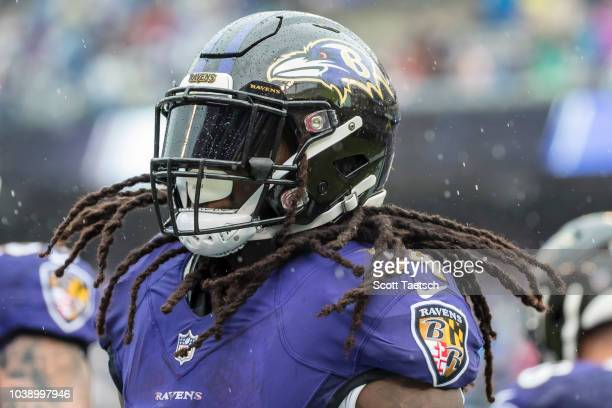 Alex Collins of the Baltimore Ravens scores a touchdown against the Denver Broncos during the first half at MT Bank Stadium on September 23 2018 in...