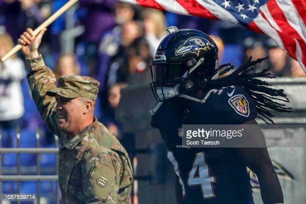 Alex Collins of the Baltimore Ravens takes the field before the game against the Pittsburgh Steelers at MT Bank Stadium on November 4 2018 in...