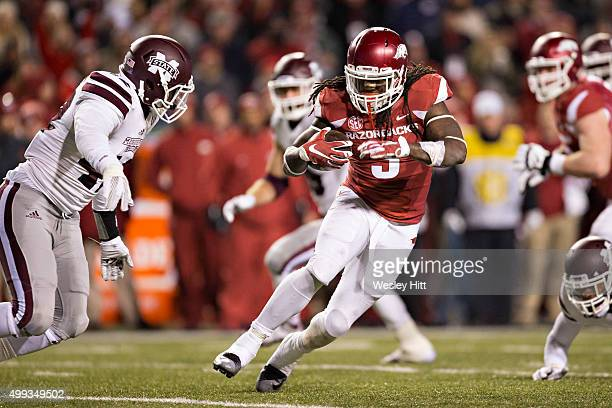 Alex Collins the Arkansas Razorbacks runs the ball against the Mississippi State Bulldogs at Razorback Stadium Stadium on November 21 2015 in...