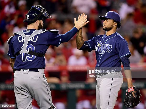 Alex Colome and Curt Casali of the Tampa Bay Rays celebrate a 42 win over the Los Angeles Angels at Angel Stadium of Anaheim on May 07 2016 in...