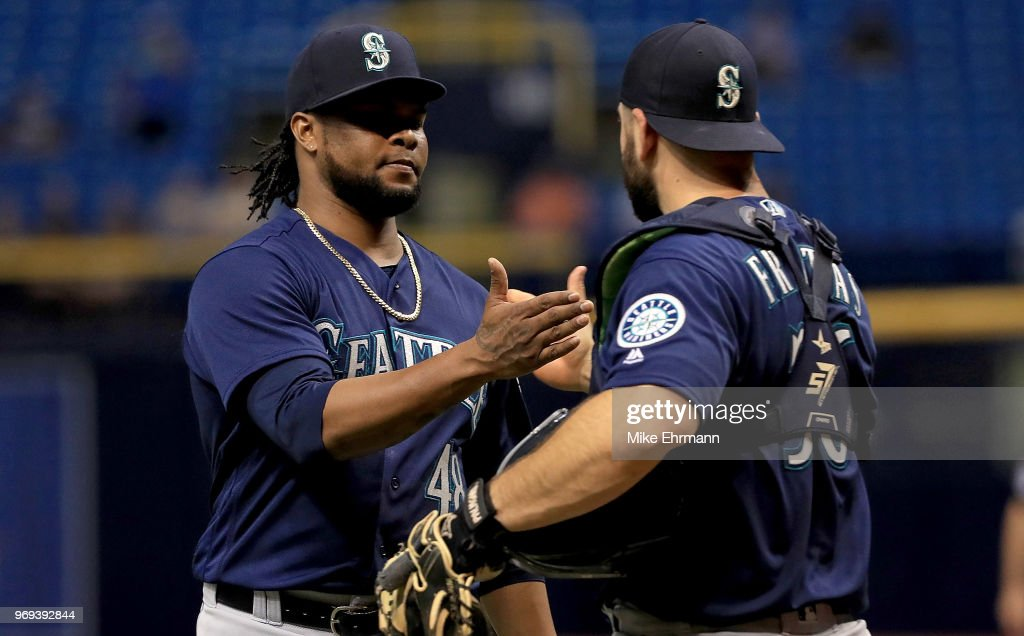 Alex Colome #48 and David Freitas #36 of the Seattle Mariners celebrate winning a game against the Tampa Bay Rays at Tropicana Field on June 7, 2018 in St Petersburg, Florida.