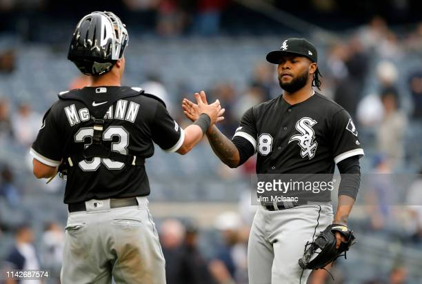 Alex Colome and James McCann of the Chicago White Sox celebrate after defeating the New York Yankees at Yankee Stadium on April 14 2019 in the Bronx...