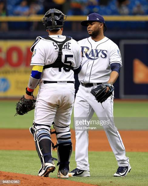 Alex Colome and Jesus Sucre of the Tampa Bay Rays celebrate winning a game against the Texas Rangers at Tropicana Field on April 18 2018 in St...