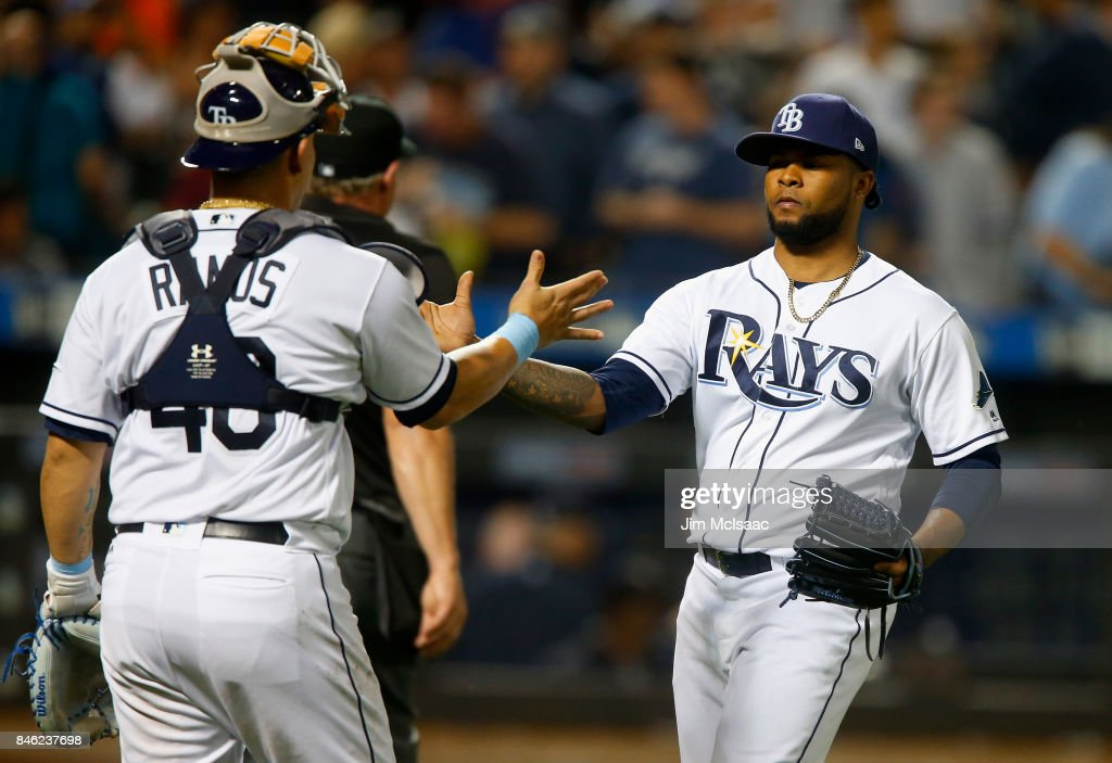 Alex Colome #37 and Wilson Ramos #40 of the Tampa Bay Rays celebrate after defeating the New York Yankees at Citi Field on September 12, 2017 in the Flushing neighborhood of the Queens borough of New York City. The two teams were scheduled to play in St. Petersburg, Florida but due to the weather emergency caused by Hurricane Irma, the game was moved to New York, but with Tampa Bay remaining the 'home' team.