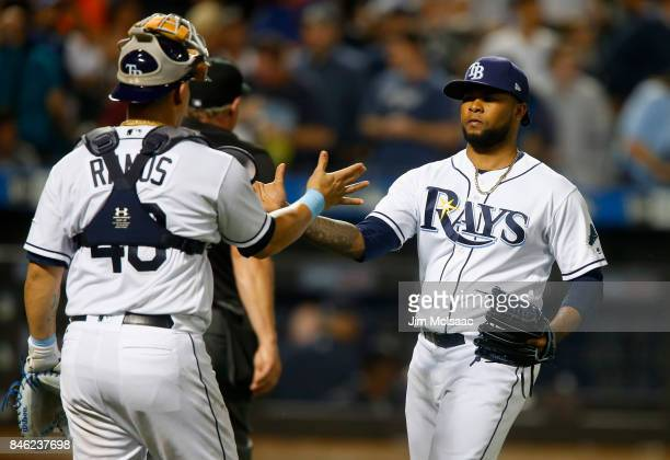 Alex Colome and Wilson Ramos of the Tampa Bay Rays celebrate after defeating the New York Yankees at Citi Field on September 12 2017 in the Flushing...