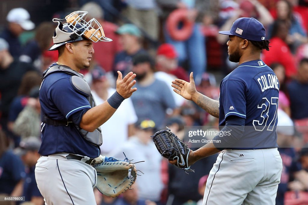 Alex Colome #37 embraces Wilson Ramos #40 of the Tampa Bay Rays after a victory over the Boston Red Sox at Fenway Park on September 10, 2017 in Boston, Massachusetts.