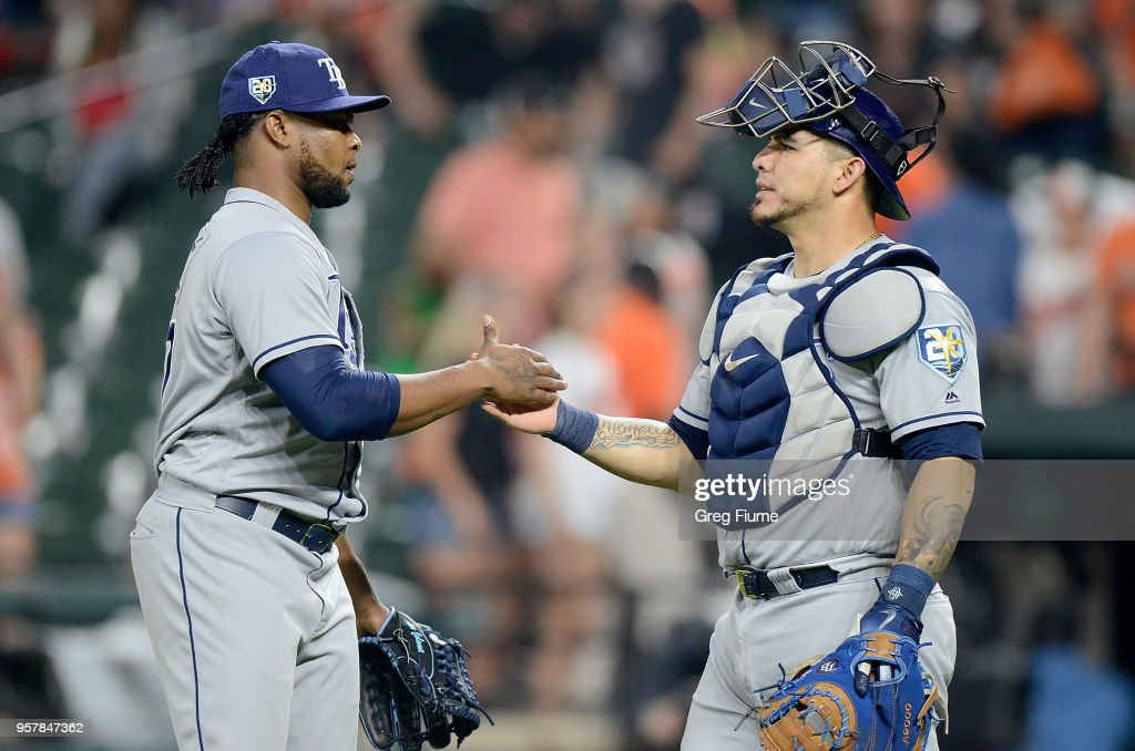 Alex Colome #37 of the Tampa Bay Rays celebrates with Wilson Ramos #40 after a 10-3 victory against the Baltimore Orioles during the second game of a doubleheader at Oriole Park at Camden Yards on May 12, 2018 in Baltimore, Maryland.