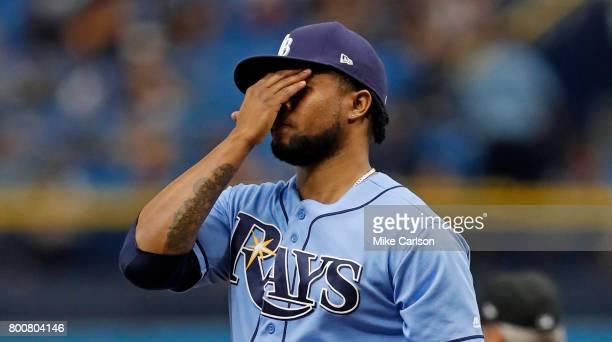 Alex Colome of the Tampa Bay Rays reacts after giving up a ground rule double to Joey Rickard of the Baltimore Orioles during the ninth inning of a...