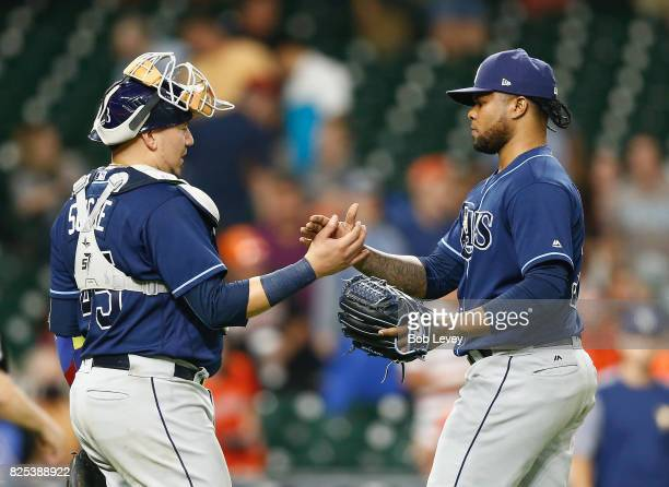 Alex Colome of the Tampa Bay Rays shakes hands with catcher Jesus Sucre after the final out against the Houston Astros at Minute Maid Park on August...