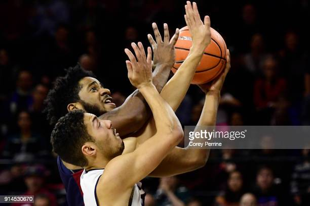 Alex Copeland of the Yale Bulldogs defends as Antonio Woods of the Pennsylvania Quakers drives to the basket during the first half at The Palestra on...